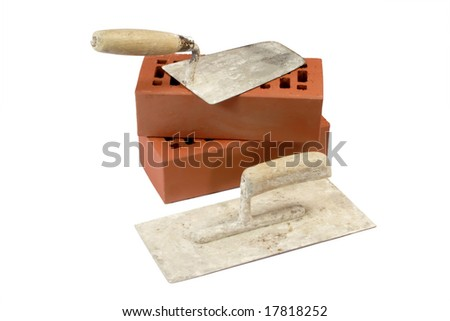 Two old trowels and red bricks - isolated on white background - stock photo