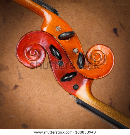 Two old violin scrolls detail over grunge background - stock photo