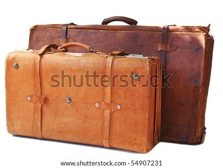 Two old weathered leather suitcases - stock photo
