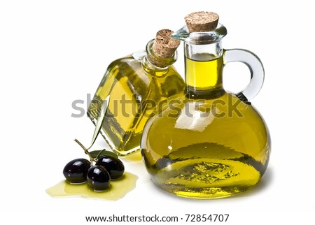 Two olive oil pourers and some olives isolated on a white background. - stock photo