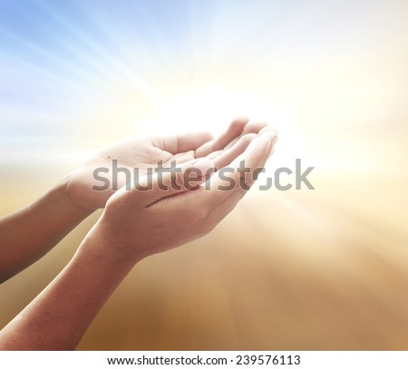 Two open empty hands with palms up, over amazing light background. Pray for support concept. Business, Environment Day, Baptism of the Jesus, World Mental Health Day, Dignity, thanksgiving concept. - stock photo