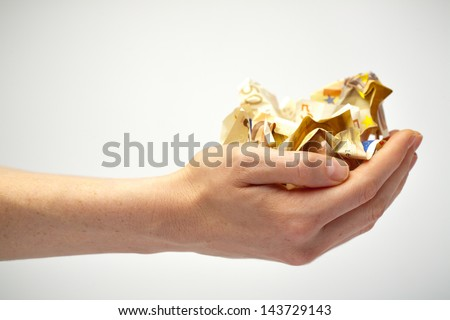 Two open hands of a woman holding a crumpled euro bills. She has just received them or is giving them away. - stock photo