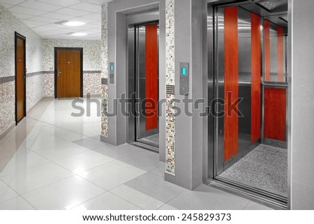 Two Open Lifts Cabin In  Multistory - stock photo