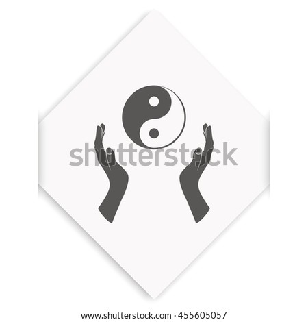 Two opened hands holding Yin Yang symbol. - stock photo