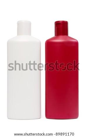 Two opposite plastic bottles - stock photo