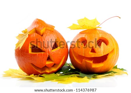 Two orange halloween pumpkins Jack O Lanterns isolated on white background - stock photo