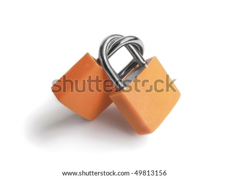 Two orange small padlocks connected to each other with the shape of heart. Love and feelings concept. - stock photo