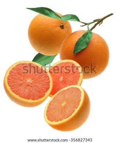 two oranges and three half with green leaves  - stock photo