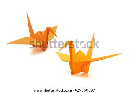 two origami cranes on white background  - stock photo