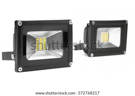 Two Outdoor 10W And 20W Waterproof RGB LED Floodlights Or Lawn Light, Or landscape Light Isolated On White Background, Close Up - stock photo