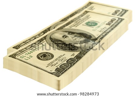Two packs of dollars isolated on a white background. - stock photo