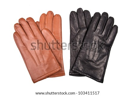 two pair of black and brown gloves isolated on white background - stock photo