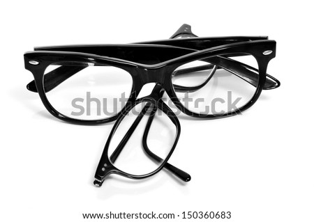 two pair of black glasses on a white background - stock photo