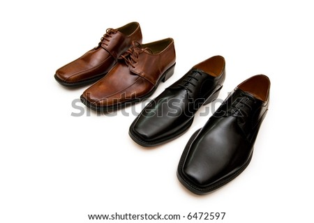 Two pairs of shoes isolated on the white - more similar photos in my portfolio - stock photo