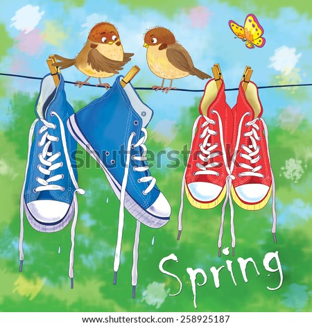 Two pairs of sneakers hanging on the rope outside on a spring day, two cute sparrows and a butterfly  - stock photo