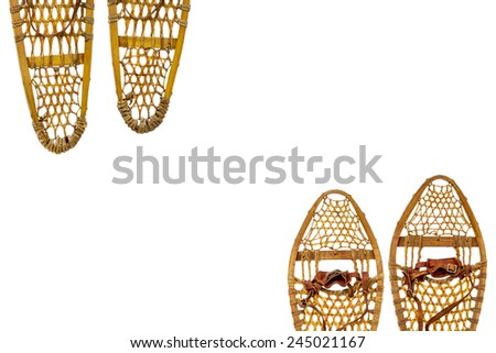 two pairs of vintage wooden snowshoes with leather binding isolated on white with a copy space - stock photo