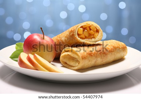 Two Pancakes with apple on holiday background - stock photo
