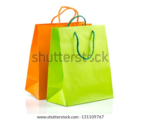 Two paper Shopping bags with reflection on white - stock photo