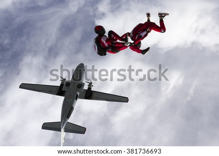 Two parachutists jumped from a plane. - stock photo