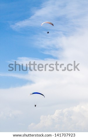 Two paragliders - stock photo