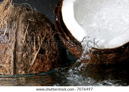 two parts of coconut under the water - stock photo
