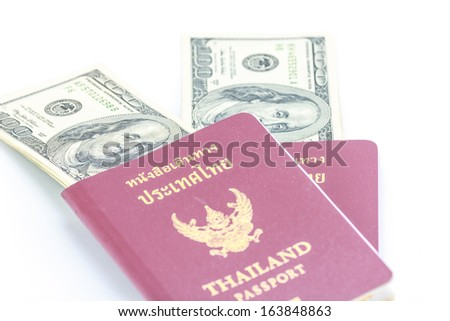Two passports Thailand with American dollars money. - stock photo