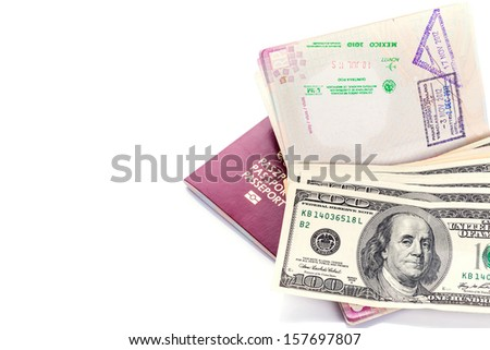 Two passports with American dollars and visa stamps - stock photo