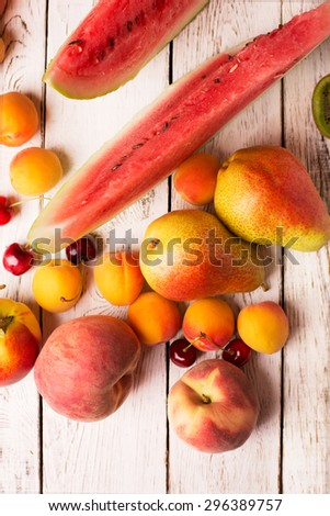 Two pears and other fruits on a wooden table - stock photo