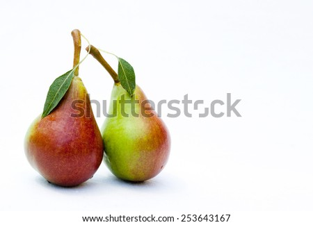 Two pears, green with the Leaf - stock photo
