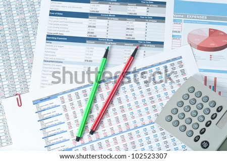two pencils and calculator over financial documents - stock photo