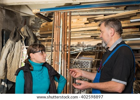 Two people discussing project architect - stock photo