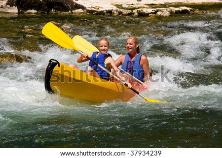 Two people in canoe enjoying holidays and nice weather - stock photo