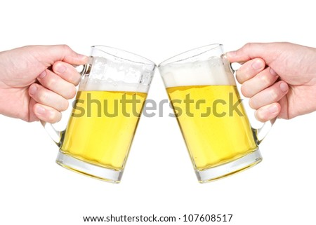 Two people making a toast with beer mugs  against white background - stock photo