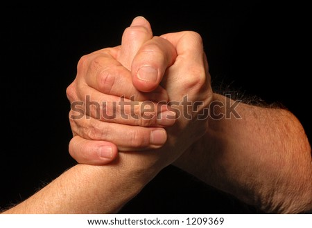 Two people meet and shake hands - stock photo