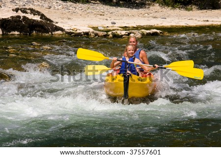 Two people on canoe in wild water, enjoy the holiday and nice weather - stock photo
