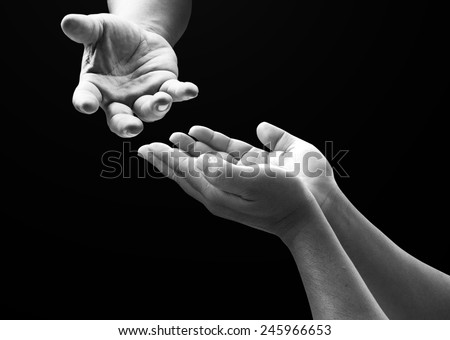 Two people open empty hands with palms up. - stock photo