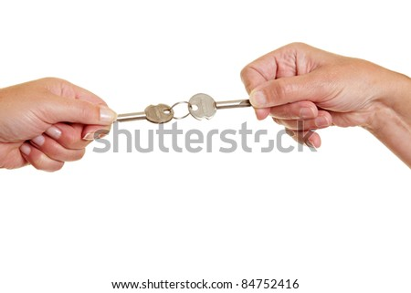 Two people pulling on keys in controversy - stock photo