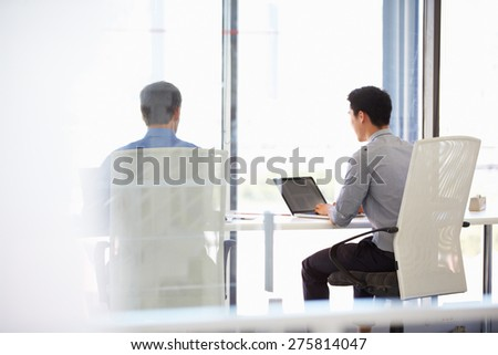 Two people working in a modern office - stock photo