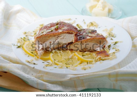Two pieces of battered chicken fillet with lemon and cheese. - stock photo