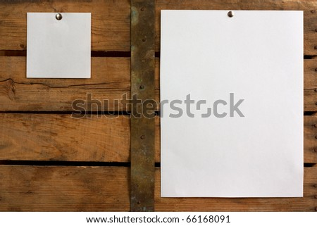 Two pieces of blank paper tacked to wooden background.Ready for your text - stock photo