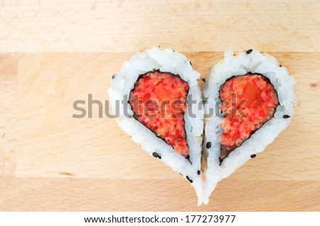 Two pieces of sushi forming the heart shape - stock photo