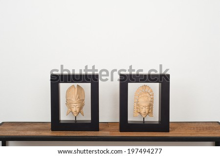 Two pieces of Thai art over side board - stock photo