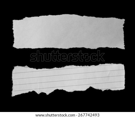 Two pieces of torn paper on black. Copy space - stock photo
