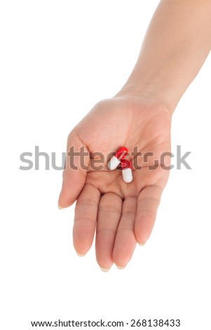 Two pills in female hand: healthcare and medicine concept - stock photo