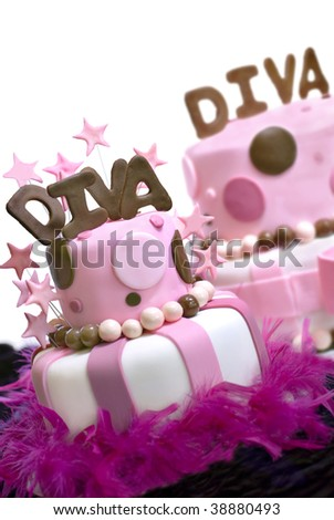 Two pink fondant cakes with Diva spelled out on top and stars garnishing the front cake.  Front cake is in focus, rear cake out of the depth of field. - stock photo