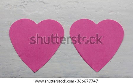 two pink paper heart on a background of white-painted surface. Copy space. Free space for text, Close-up, top view - stock photo