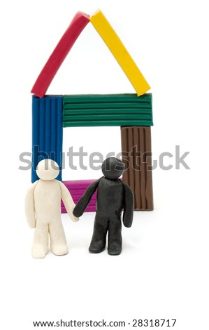 Two Plasticine persons against the house - stock photo