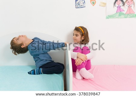 Two playful kids having fun in their room - stock photo