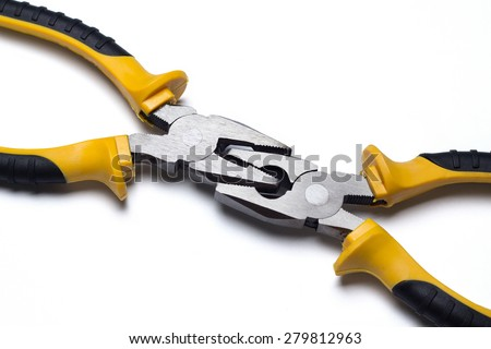 two pliers bonded to each other - stock photo
