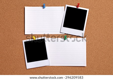 Two polaroid frame photo prints, white index cards, cork pinboard.  Copy space.  - stock photo